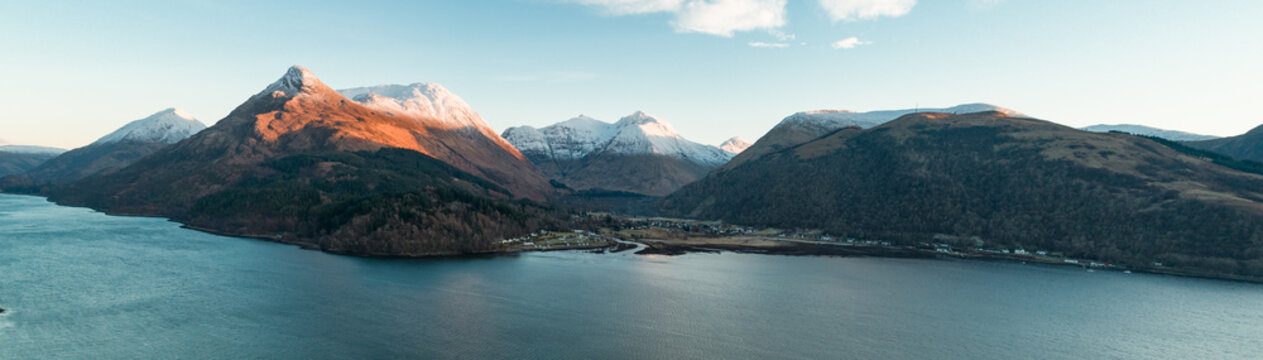 Aerial View of Glencoe and the Mountains Surrounding The Small Town in Scotland