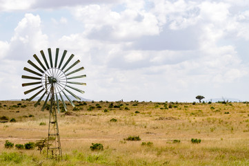 Water pump powered by a wind turbine in the savannah of the Masai Mara Park in Kenya