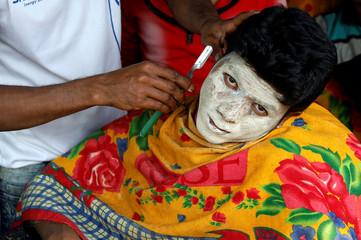 A Rohingya refugee gets a hair cut at Kutupalong camp, near Cox's Bazar