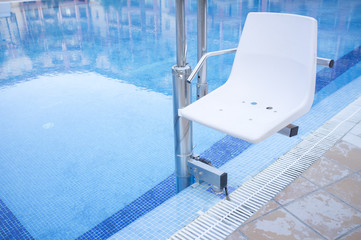Swimming pool lift for disabled people access to the pool