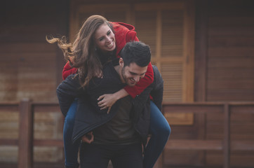 Man and young woman pose and have fun in love.