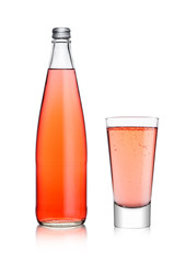 Bottle and glass of sparkling pink soda lemonade