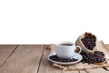 coffee cup and coffee beans on old wood plank background.