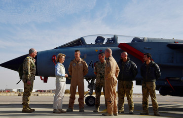 German Defence Minister Ursula von der Leyen speaks to German air force pilots as she visits the German contingent at the Al Azraq air base in Jordan