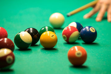 Billiards balls and cue