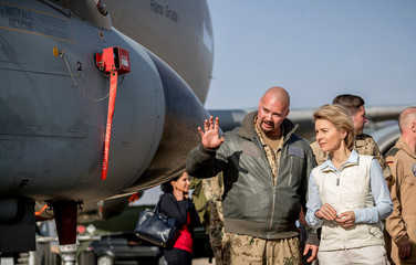 German Defence Minister Ursula von der Leyen speaks to a German air force pilot as she visits the German contingent at the Al Azraq air base in Jordan