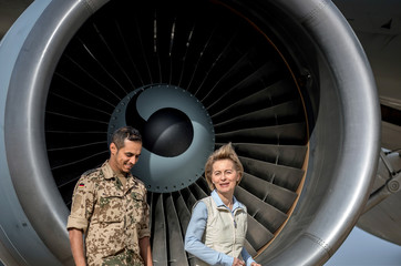 German Defence Minister Ursula von der Leyen speaks to a German soldier as she visits the German contingent at the Al Azraq air base in Jordan