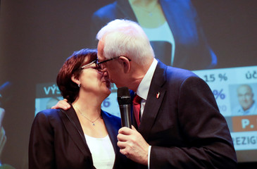 Czech presidential candidate Jiri Drahos kisses his wife Eva as he delivers a speech at his headquarters, after polling stations closed for the country's direct presidential election