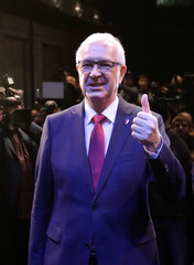 Czech presidential candidate Jiri Drahos gestures at his headquarters, after polling stations closed for the country's direct presidential election, in Prague