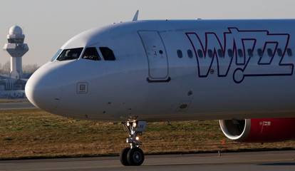 Wizz Air Airbus 321-231 HA-LXJ aircraft taxis to runway at the Chopin International Airport in Warsaw