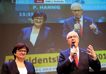 Czech presidential candidate Jiri Drahos next to his wife Eva delivers a speech, after polling stations closed for the country's direct presidential election, in Prague
