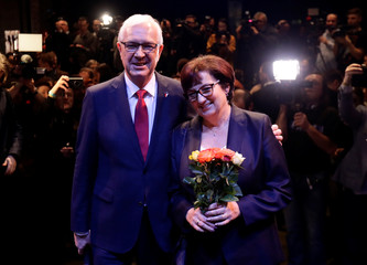 Czech presidential candidate Jiri Drahos pose for a photo with his wife Eva at his headquarters, after polling stations closed for the country's direct presidential election, in Prague