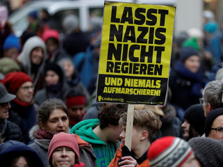 Protestors hold signs during an anti-government demonstration in Vienna