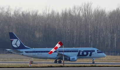 Polish Airlines LOT Embraer ERJ-175LR SP-LIL aircraft is seen landing at the Chopin International Airport in Warsaw