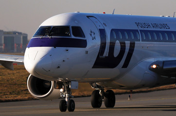 Polish Airlines LOT Embraer ERJ-175LR SP-LIM aircraft taxis to runway at the Chopin International Airport in Warsaw