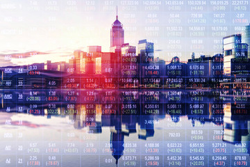 Double exposure of stocks market chart in blue on LED display concept with city scape hong kong background