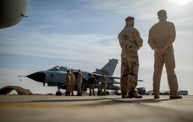 German air force pilots stand next to a figher jet during a visit of Defence Minister Ursula von der Leyene at the Al Azraq air base in Jordan