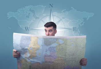 Young man holding map