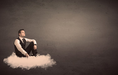 Man sitting on a cloud with plain background