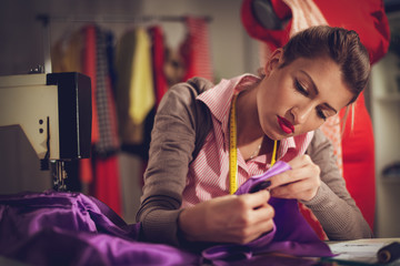 Young Woman Tailor Sewing