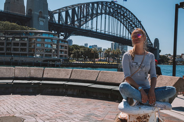 Young girl chilling in Sydney near Opera house and Darling harbour by the bay.