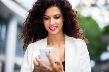 Young woman using a smartphone outdoor