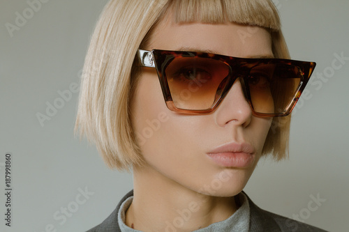 79e10eceadd8 Blonde girl with short hair style in fashion glasses