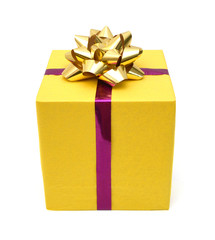 gift yellow box with gold ribbon bow close up isolated on white background