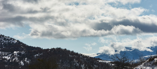 Winter mountain village landscape with snow