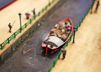 The world in miniature. Boat on the river.