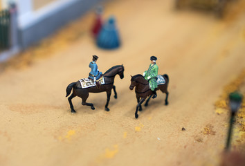 The world in miniature. Soldiers on horseback.