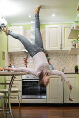 Upside down House. Woman on the kitchen.