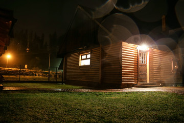 Comfortable log house for tourists in evening