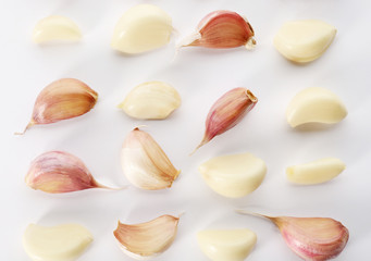 Composition with garlic cloves on white background