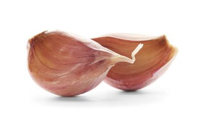 Fresh garlic cloves on white background