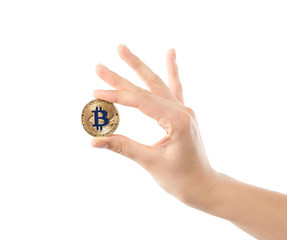 Female hand with golden bitcoin on white background