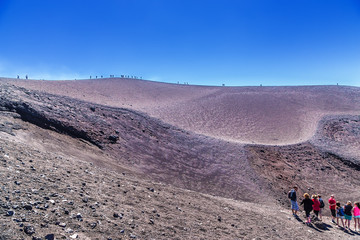 "he volcano of Etna, Sicily, Italy. Tourists in the middle of the ""Martian"" landscape"