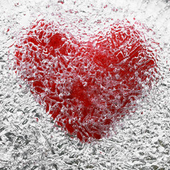bright red heart symbol is covered with cold, clear ice