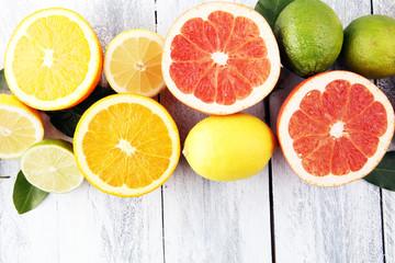 Citrus background. Assorted fresh citrus fruit. Lemon, orange lime, grapefruit. Fresh and colorful concept.