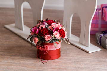 gift for Valentine's Day in the form of a flower bucket
