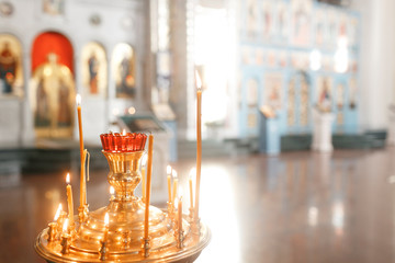 Accessories for the christening of children icons of candles and font, the Ortodox Church. The Sacrament of Children