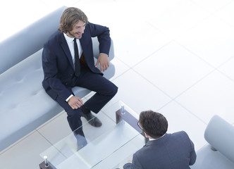 two businessmen discussing in the workplace