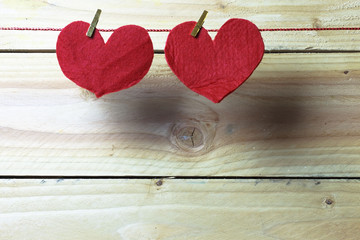 Hearts hanging on rope on wooden background. Free space for text.