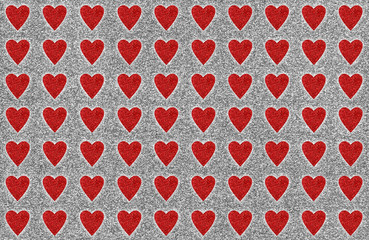 Glitter red hearts textured background Valentine's day cupid card