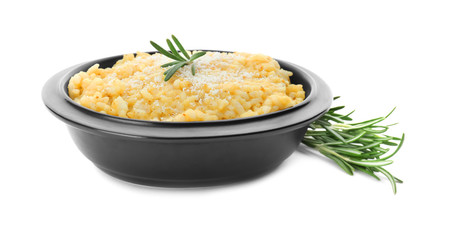 Bowl with delicious risotto on white background