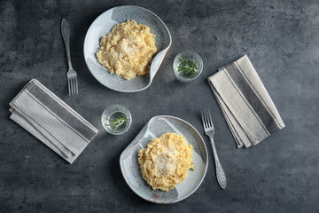 Plates with delicious risotto on table