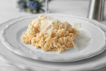 Plate with delicious risotto on table, closeup