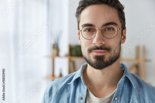 e106b6c0e12 Close up portrait of handsome bearded man wears round spectacles ...