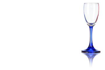 Empty liquor glass on the blue leg.