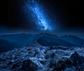 Fototapete - Beautiful milky way in mountains at night in Poland